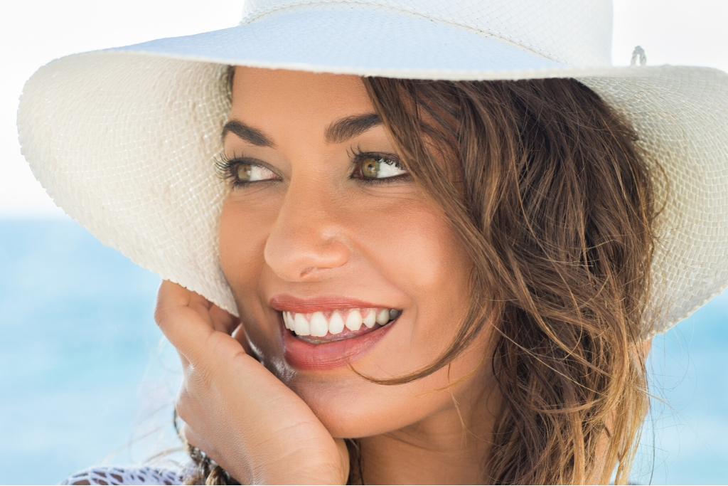 Woman In A White Hat With Makeup | Skinn Bar