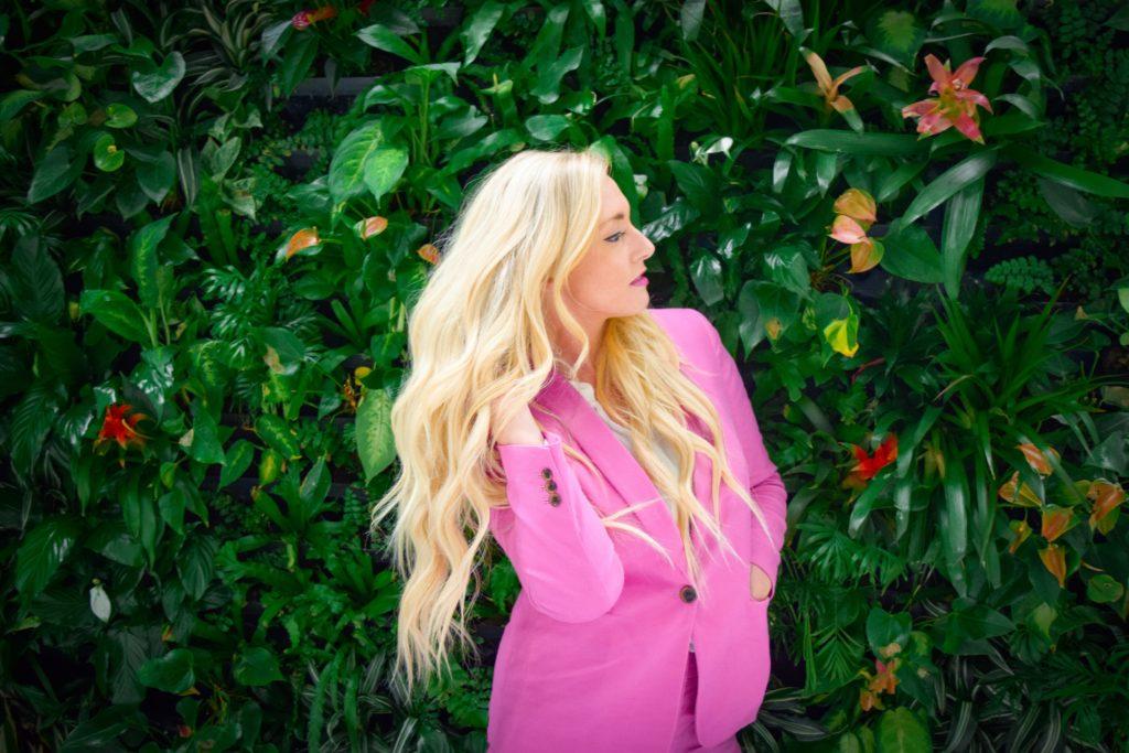 Woman In A Pink Coat | Skinn Bar